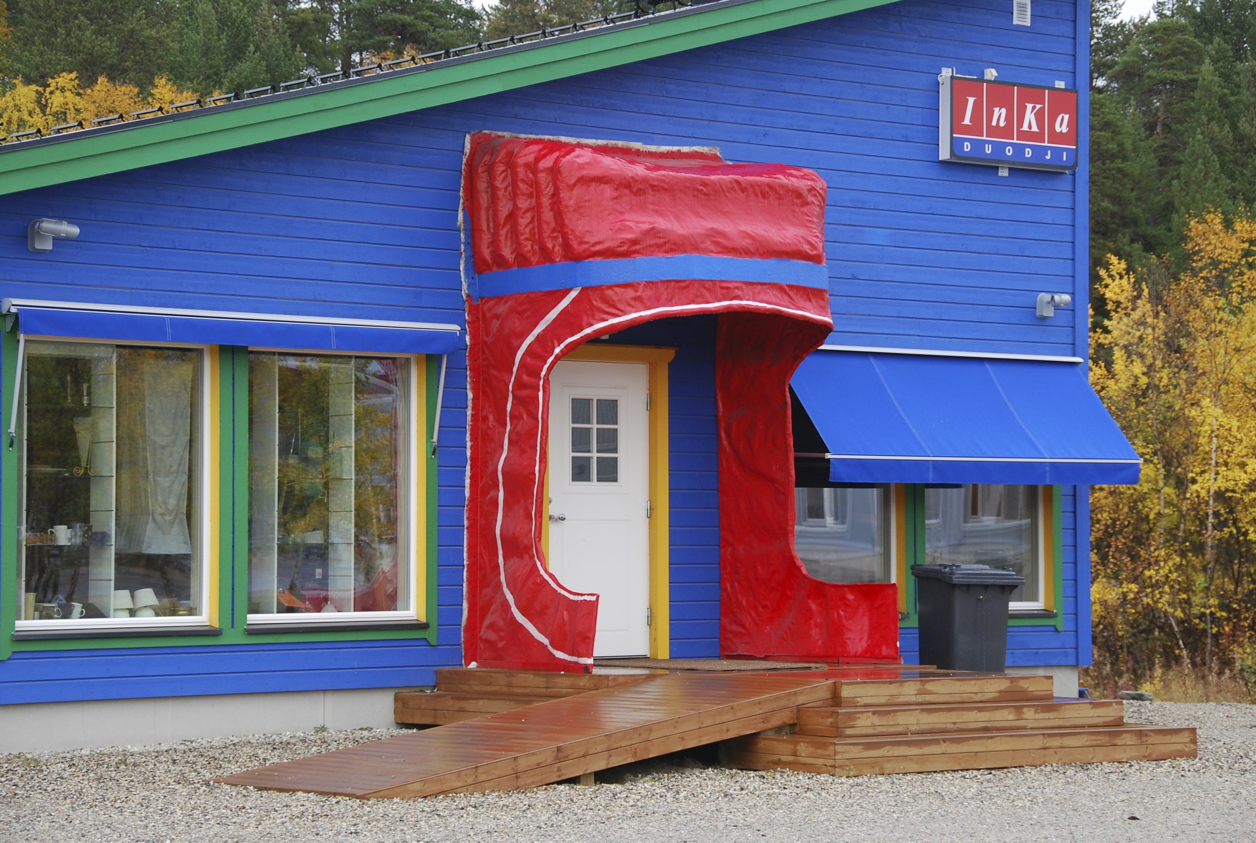 A handcraft shop in Karasjok that has a hilarious door covering that mimics a woman's cap.