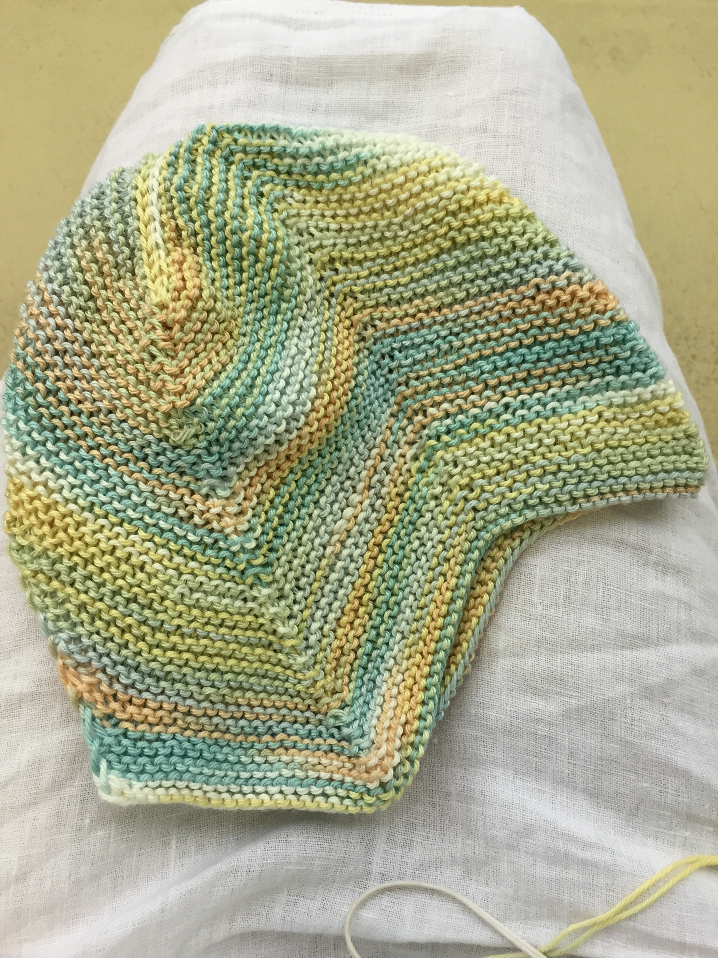 Garter Stitch baby cap before i-cord ties.