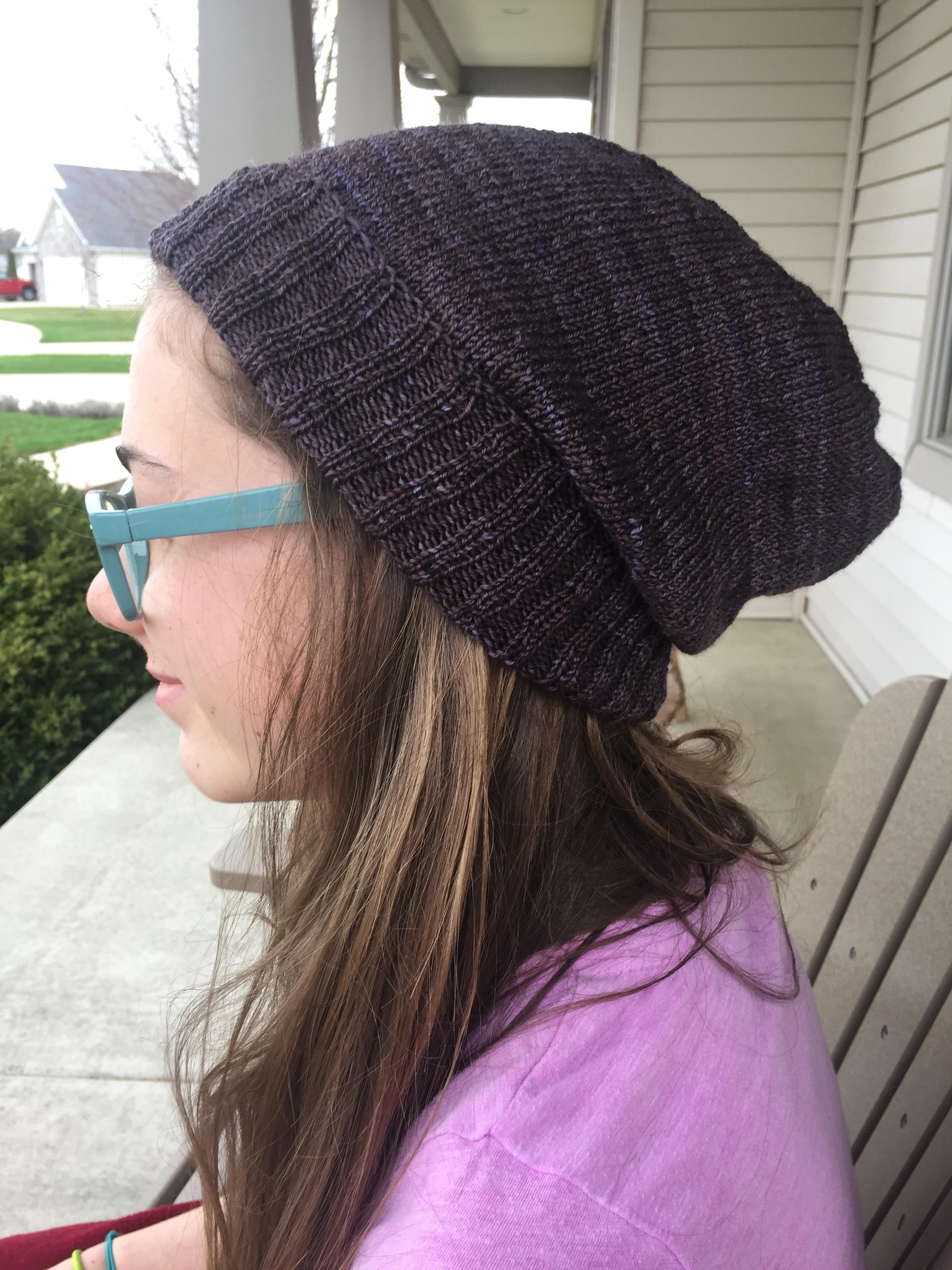 "Daughter modeling ""Sock Head"" pattern with Malabrigo sock yarn"