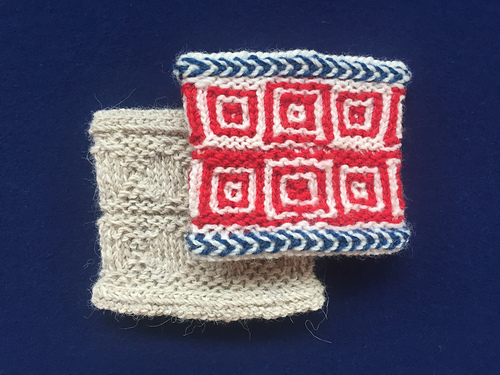 Class wrist warmer cuffs, knitted in a solid color, and three different colored z-spun yarns