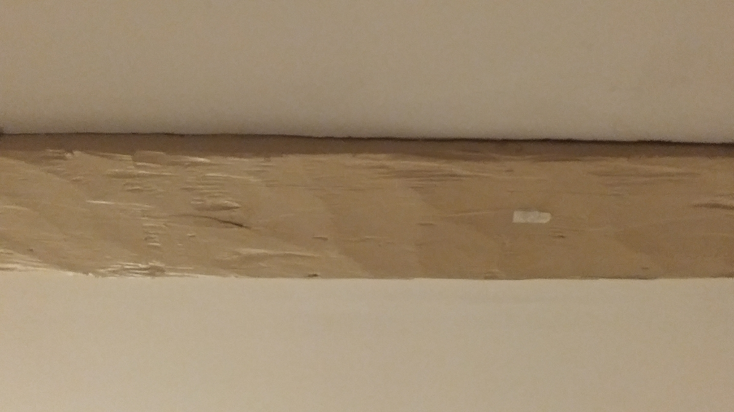Someone decided that painting 200 year old beams was a good idea!
