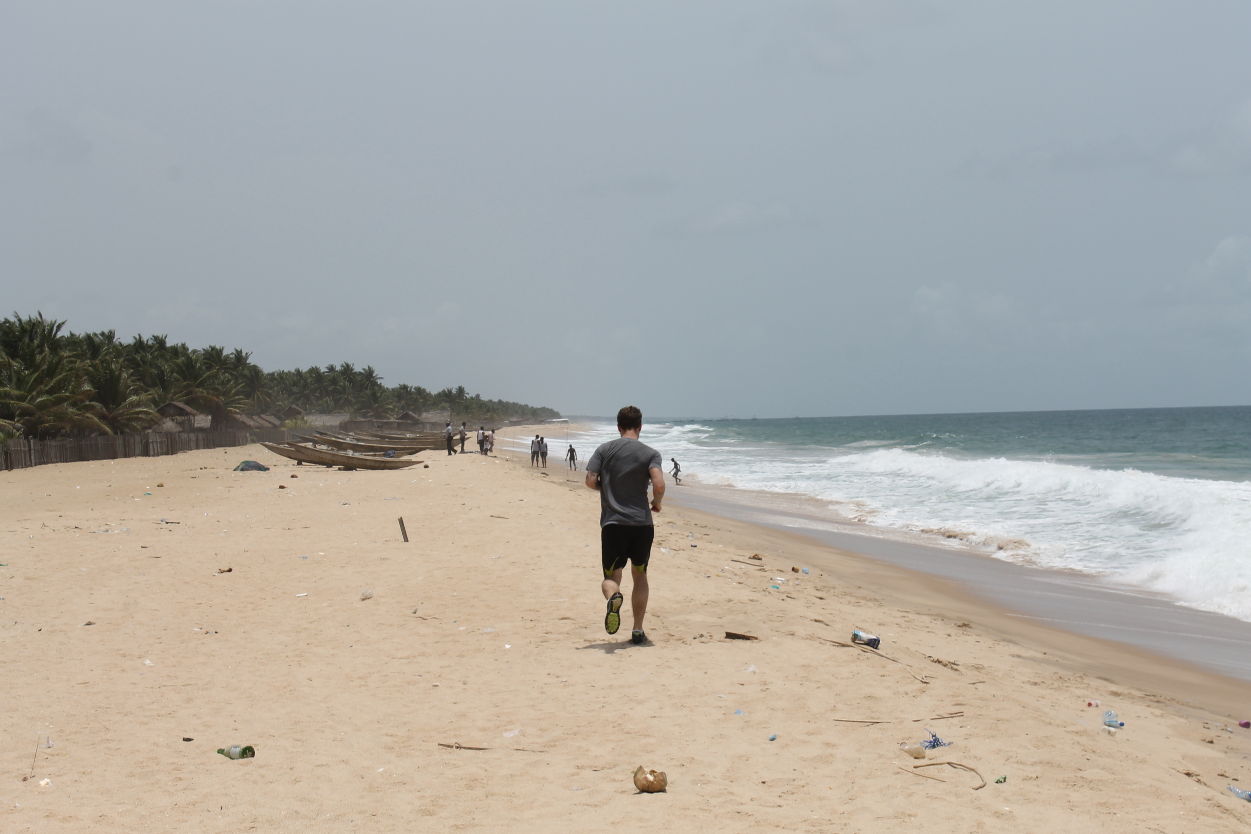 E hitting a beach run on Eleko Beach outside of Lagos, Nigeria. March 24, 2013.