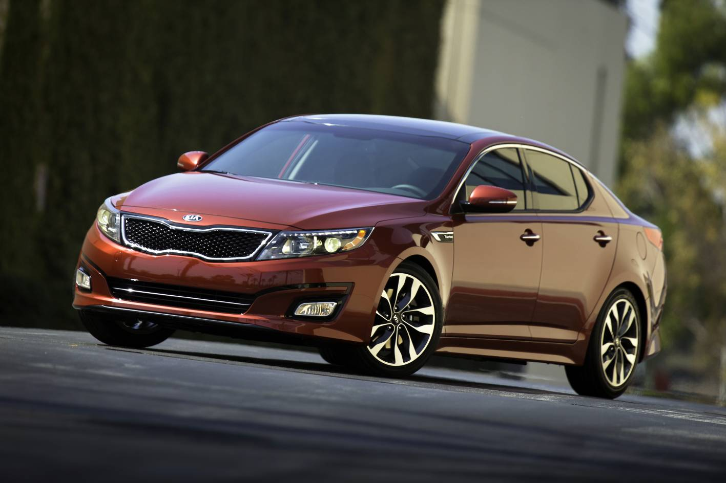 Kia Optima - everything I just said about the Santa Fe (left) ... only it's a car