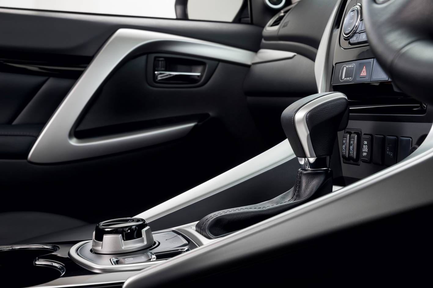 Pajero Sport's interior silver highlights look very classy (win); unfortunately they reflect a lot of ambient sunlight right back at you (fail)...