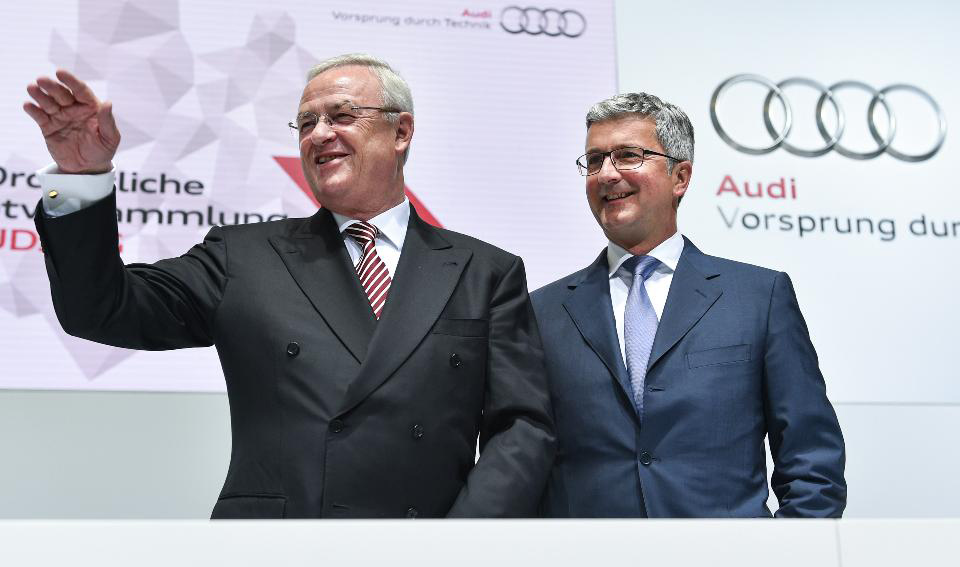 Happier times: An apparently friendly 'seig heil' from ousted VW boss Martin Winterkorn (left) and Audi CEO Rupert Stadler (right) ... before they both looked like reprehensible crooks (personal opinion)