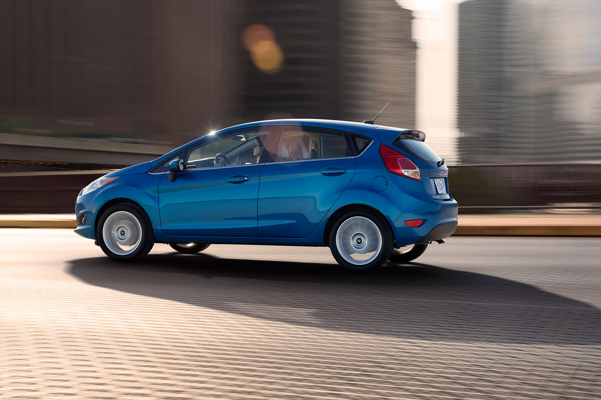 Ford Fiesta Don't Buy  - instead, buy the   Mazda2  , which is a better car in every respect, including build quality and reliability