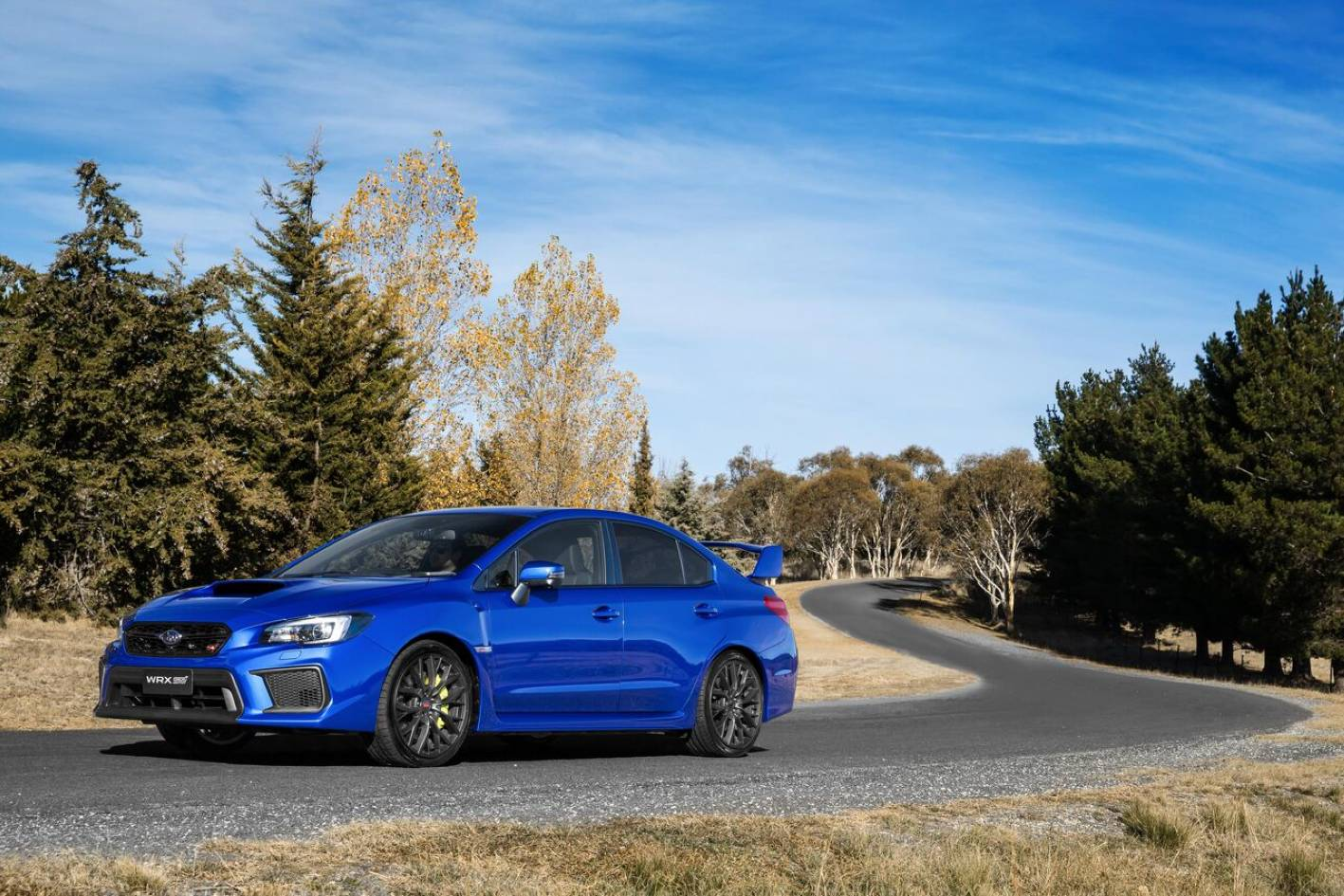 STI has the bragging rights - but many buyers would have their objective needs met by a notionally 'lesser' WRX