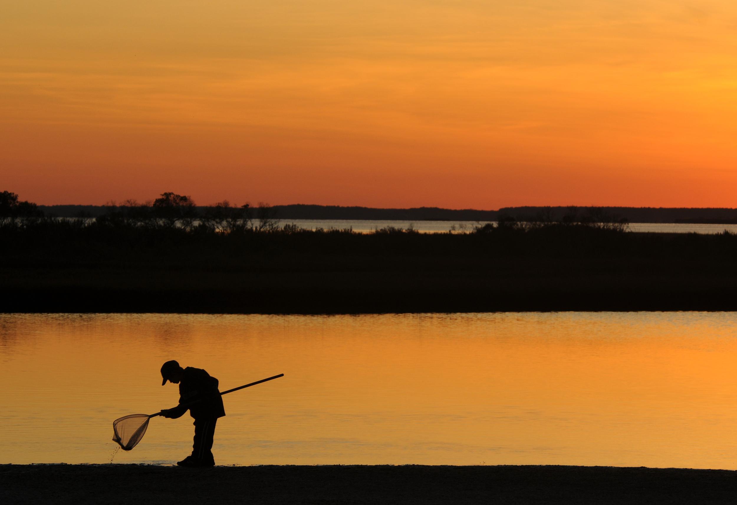 On Delmarva: Child crabbing at sunset