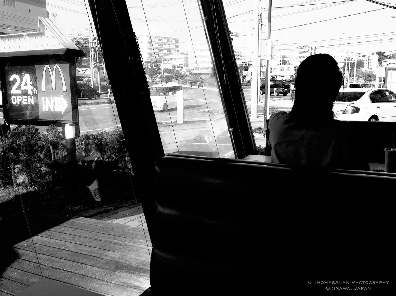Lady having breakfast at McDonald's in Okinawa Japan.