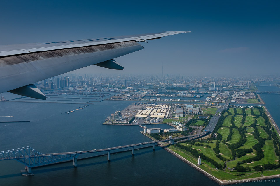 Tokyo 2014. Landing at Haneda Airport in Tokyo on a hazing day the skyline definitely looks different that it did in 1982. Fuji x100s