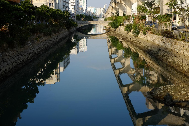 Reflections in the river. Naha, Okinawa, Japan. Fuji x100s w/ TCLx100 Teleconverter at ISO 200, f8, 1/220 sec.