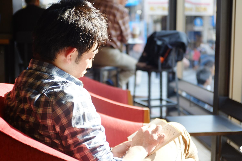 A man reading a book at Starbucks on Kokusai street in Naha, Okinawa, Japan. Fuji x100s w/ TCLx100 Teleconverter at ISO 400, f2, 1/80 sec.