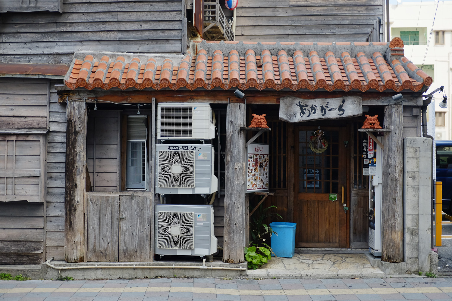 Old and new together in Naha, Okinawa, Japan. Fuji x100s w/ TCLx100 Teleconverter at ISO 800, f2.8, 1/200 sec.