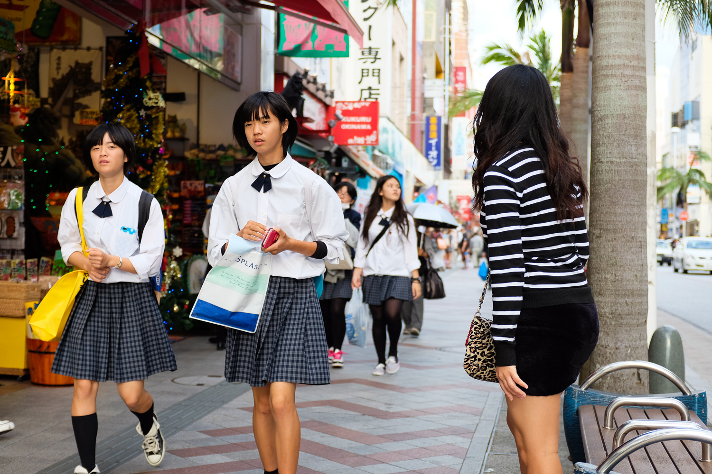 Students walking on Kokusai street in Naha, Okinawa, Japan. Fuji x100s and TCLx100, ISO 400, f2.8, 1/500 sec.