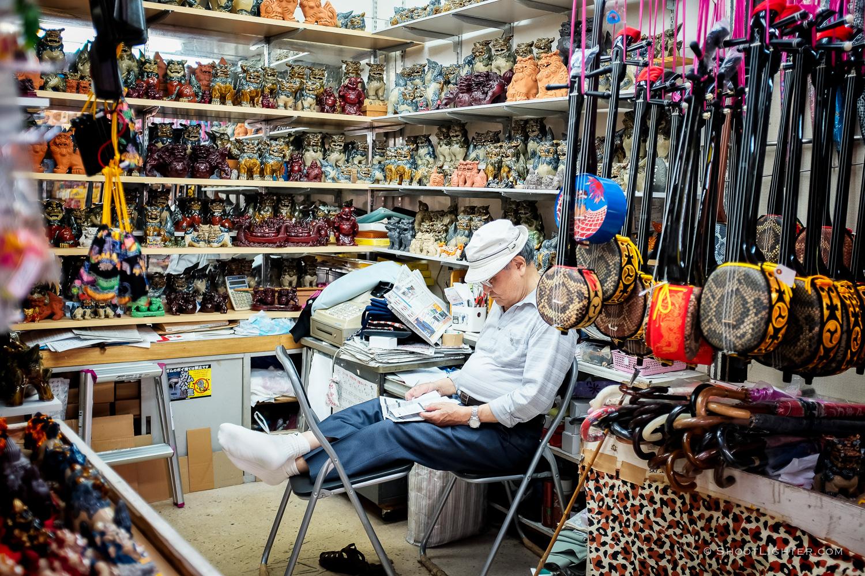 An Okinawan Sanshin 三線 shop keeper in Naha, Okinawa Japan. Fujifilm x100T, ISO 400, f/2.0, 1/80 sec, Fujifilm chrome film emulation, edited in Adobe Lightroom 6.