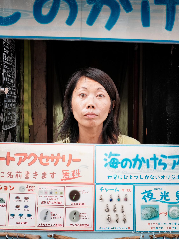 Womanmanningasmall jewelry shop on Kokusai street in Naha, Okinawa Japan. Fujifilm x100T, ISO 400, f/5.6, 1/110 sec, Fujifilm chrome film emulation, edited in Adobe Lightroom 6.