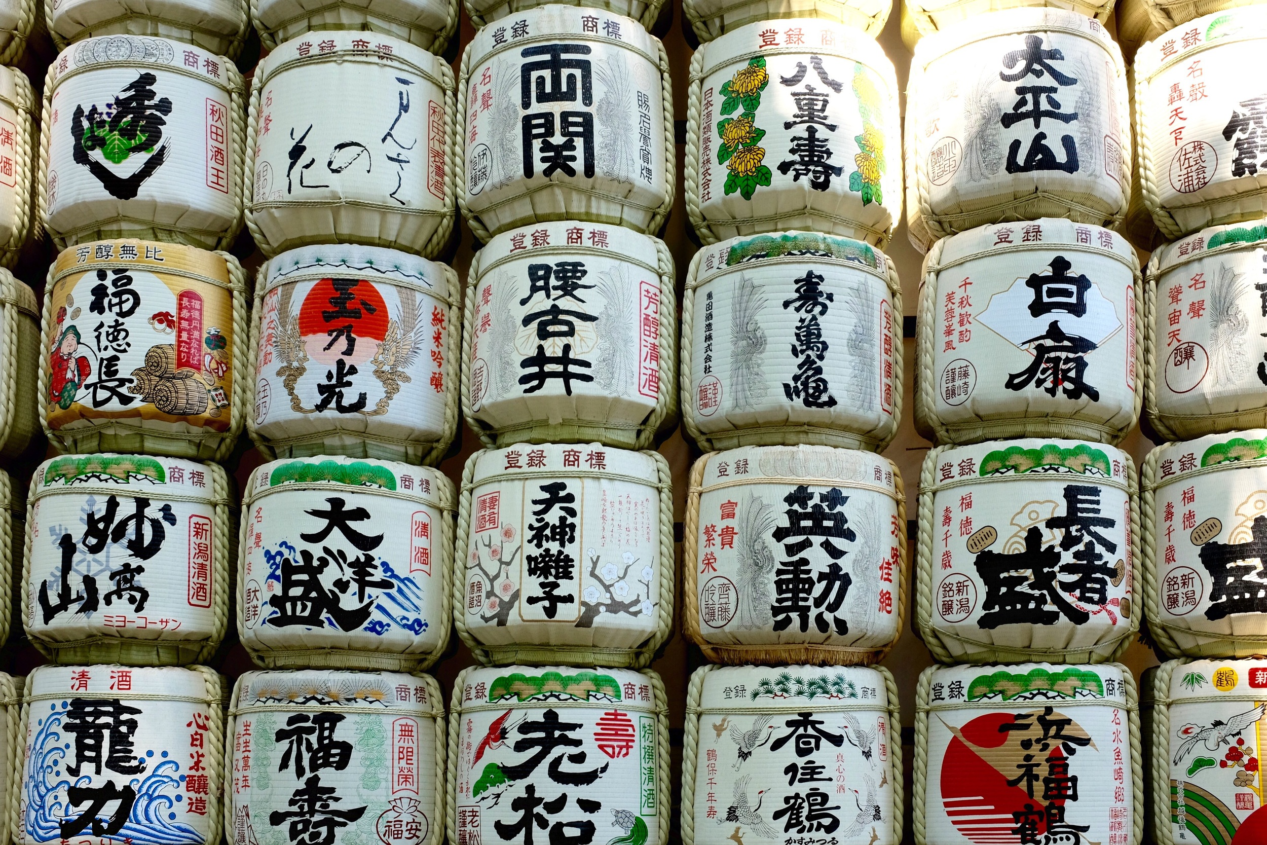 Barrels of sake donated to the shrine. Fujifilm x100t, ISO 640, f/8, 1/60 sec. Edited to fix perspective and added contrast.