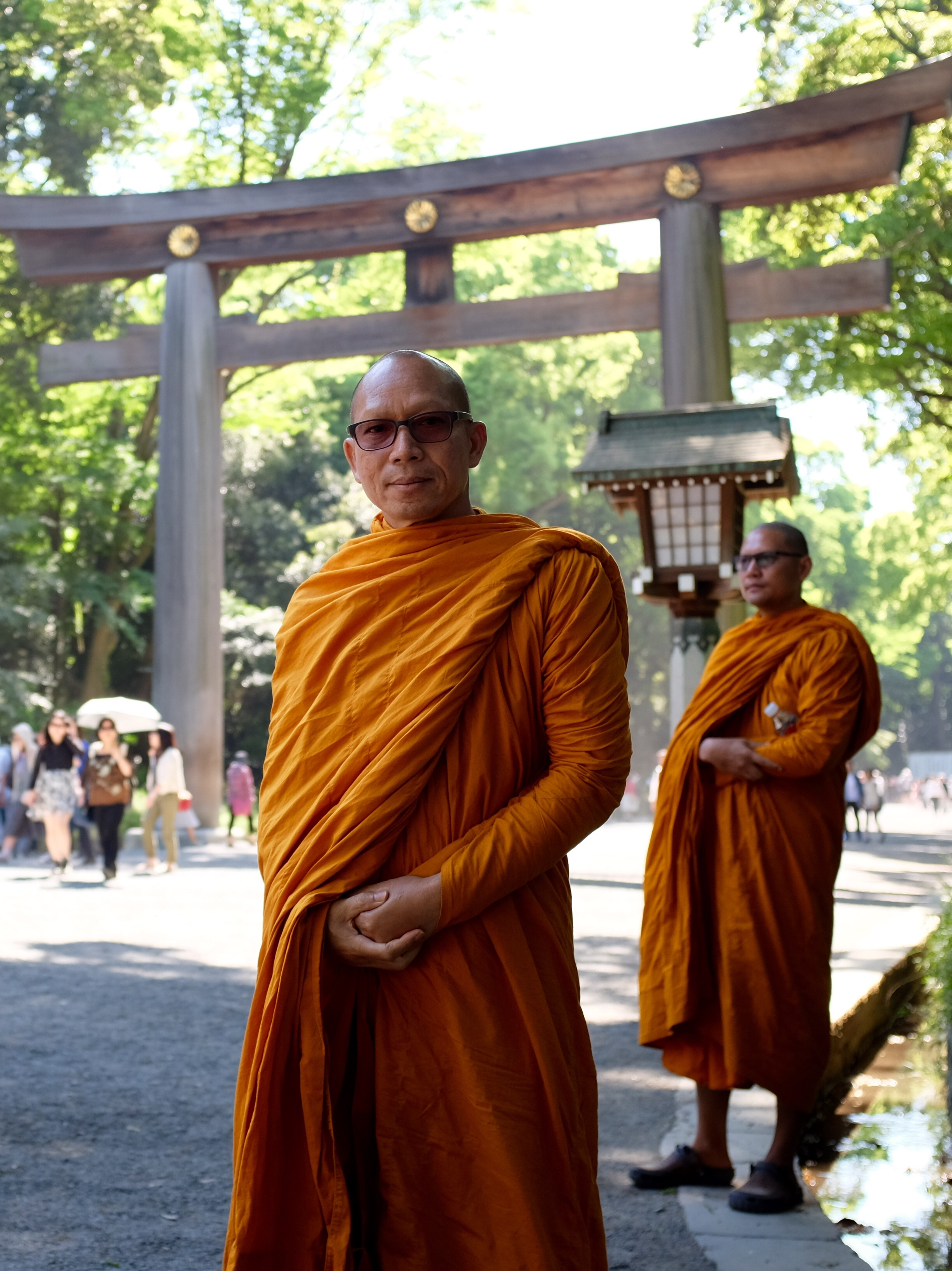 Monks at Meiji Shrine, Tokyo. Fujifilm x100t, ISO 400, f/2.8, 1/400 sec. ND filter on. Cropped and added some contrast.
