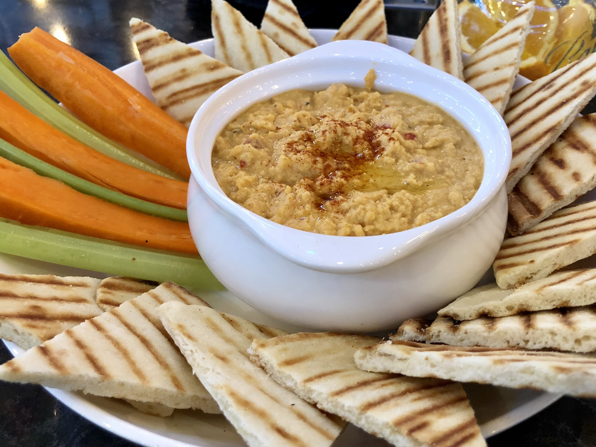 Funny how the simple things are the things you enjoy the most sometimes. This hummus plate with pita bread and veggie sticks was awesome! Photographed well too. :)