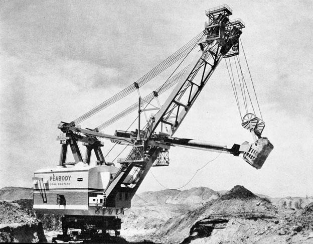 Neuf mille tonnes d'acier, une hauteur équivalente à celle d'un immeuble de vingt étages, telles sont les dimensions de la pelle de découverture 3850-B qui fut mise en service en août 1962. Elle a été construite et conçue par Bucyrus-Erie à Milwaukee dans le Wisconsin pour le compte de la société Peabody Coal C°. Sa portée est de 128 m et son rendement peut aller jusqu'à 75.000 m3 par jour (27.500.000 m3/an). Son poids en ordre de marche dépasse les 9.000 t et sa flèche surplombe de 80 m le terrain sur lequel la pelle évolue. Elle se déplace sur quatre jeux de trains de chenilles jumeaux de 2,50 m de haut et composés de 296 patins d'acier pesant chacun presque 2 t ! Toute la puissance utilisée par la 3850-B est électrique, fournie par 52 moteurs développant entre 1/4 et 3.000 CV. La puissance totale est de 8.948 kW (12.169 CV). Ce «monstre » d'acier, dont le poids dépasse celui d'un croiseur léger, est en mesure d'avaler 200 tonnes de roche et de terre en un seul coup de godet de… 87.360 litres ! La largeur hors tout de la 3850-B peut être comparée à celle d'une autoroute à huit bandes de circulation. Trois cents wagons de chemin de fer ont été nécessaires pour amener les éléments depuis l'usine jusqu'à la mine de charbon située dans le Kentucky. Temps de montage : 11 mois !      Lima 1200