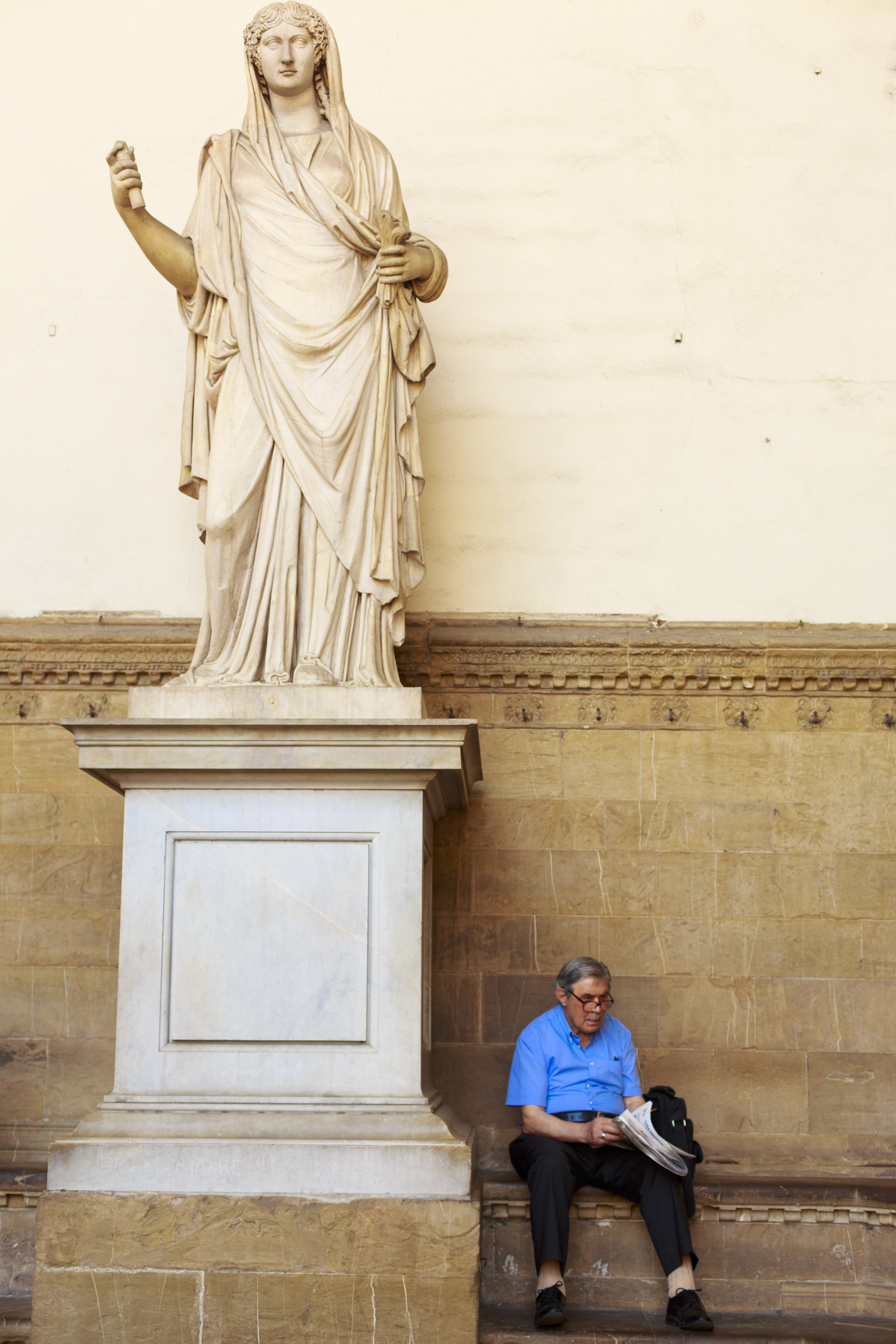 Statue and Man Reading