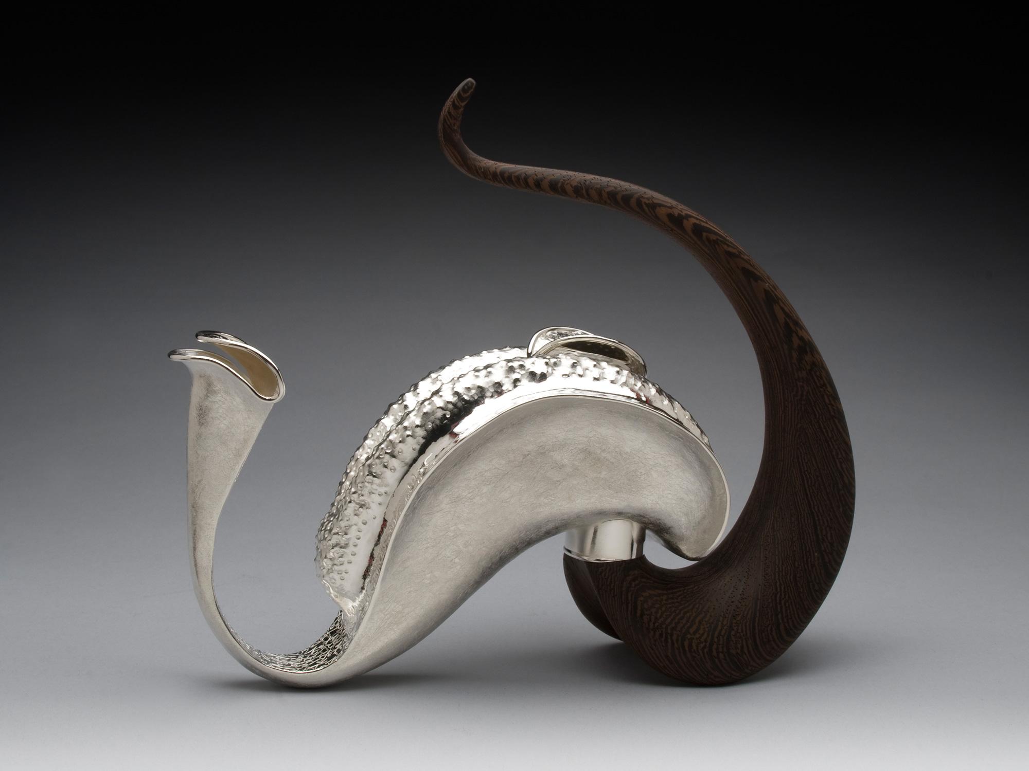 METALANGUAGE   Teapot | 2012 |  Mary Lynn Podiluk   Silver-plated copper, wenge wood, cork 18.5H x 21W x 7D cm
