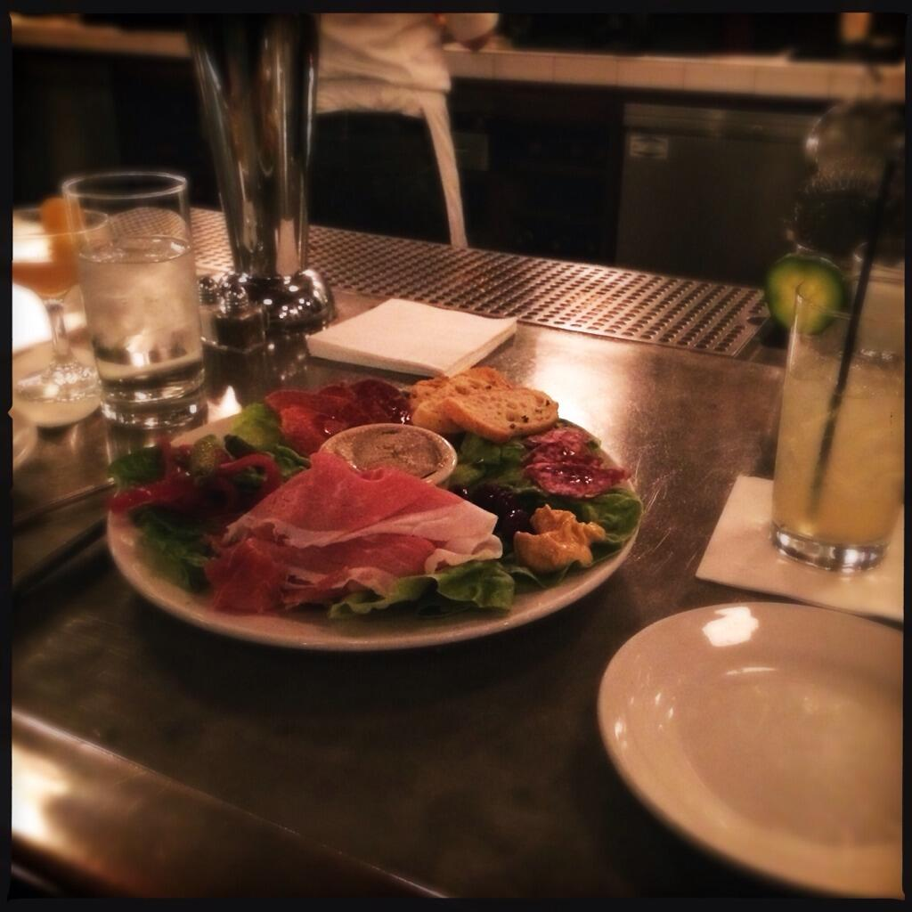 The Sardine charcuterie plate. An old standby for bar dining. (Photo credit: Kristine Nabilcy)