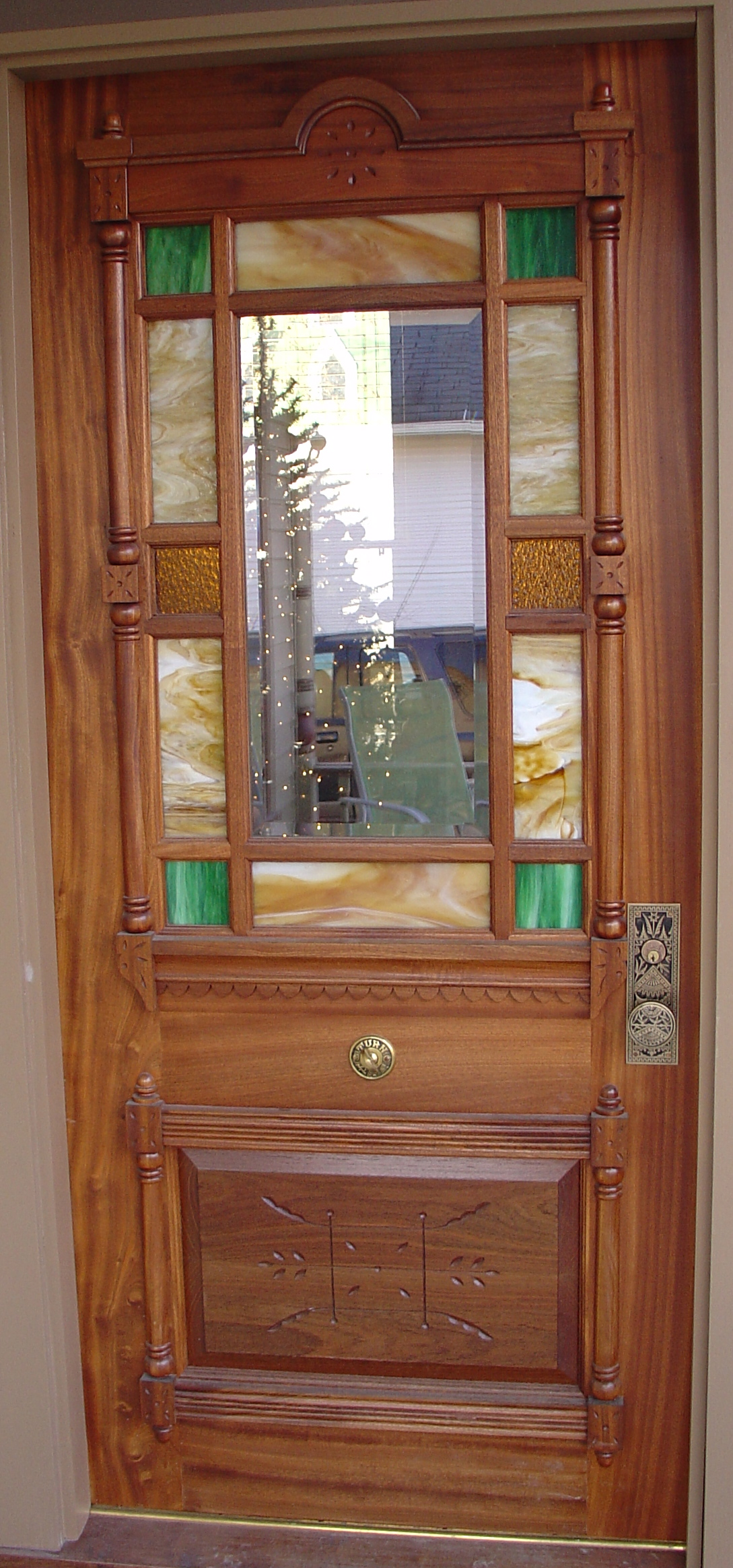 """Reproduction door. 2 1/4"""" sapele with IG art glass and bevelled glass lites."""