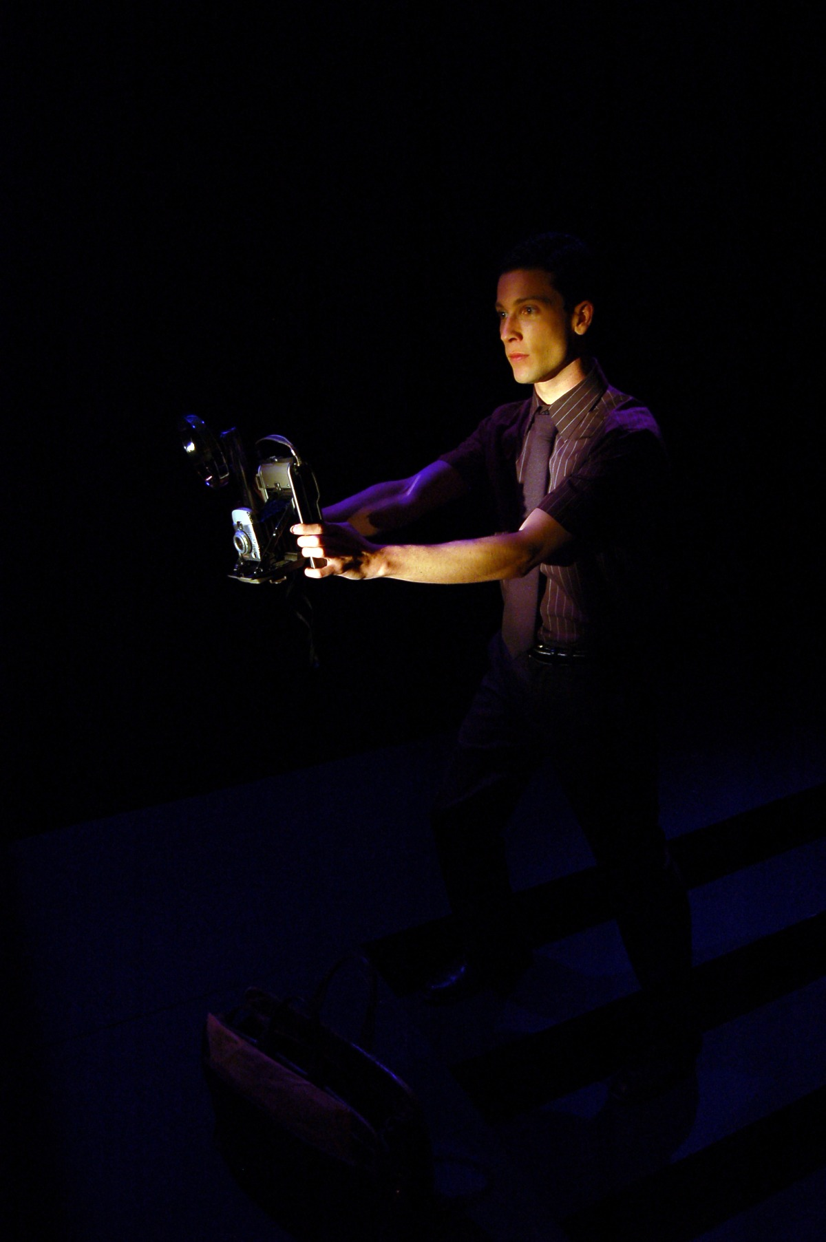Michael Phillips (Young Lucius).    Scenic Design by Javier Rodriguez, Costume Design by Ben Randle, Dresses by Mr. David, Lighting Design by Nick Brandon