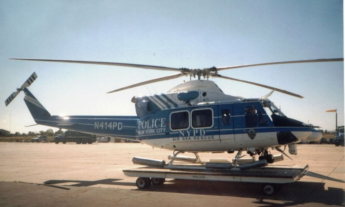 The four bladed Bell 412; Note the external hoist above the door for rescues, the search light & camera under the nose and the pop out floats on the landing gear for emergency water landings.