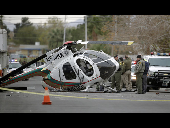 N530KK where it came to rest on 23rd Street near Downtown Las Vegas on New Years Eave 2014. The helicopter was purchased in 2010 from MD Helicopters. Both crew members survived. Photo credit John Locher, AP
