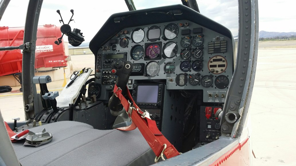 A look into the Pilot's workspace- the cockpit of the OV-10, a Cal Fire Captain or Chief sit's behind the pilot directing aircraft on fires.