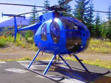 An MD500D turbine powered helicopter such as this can often be found for between $300,000 and $600,000