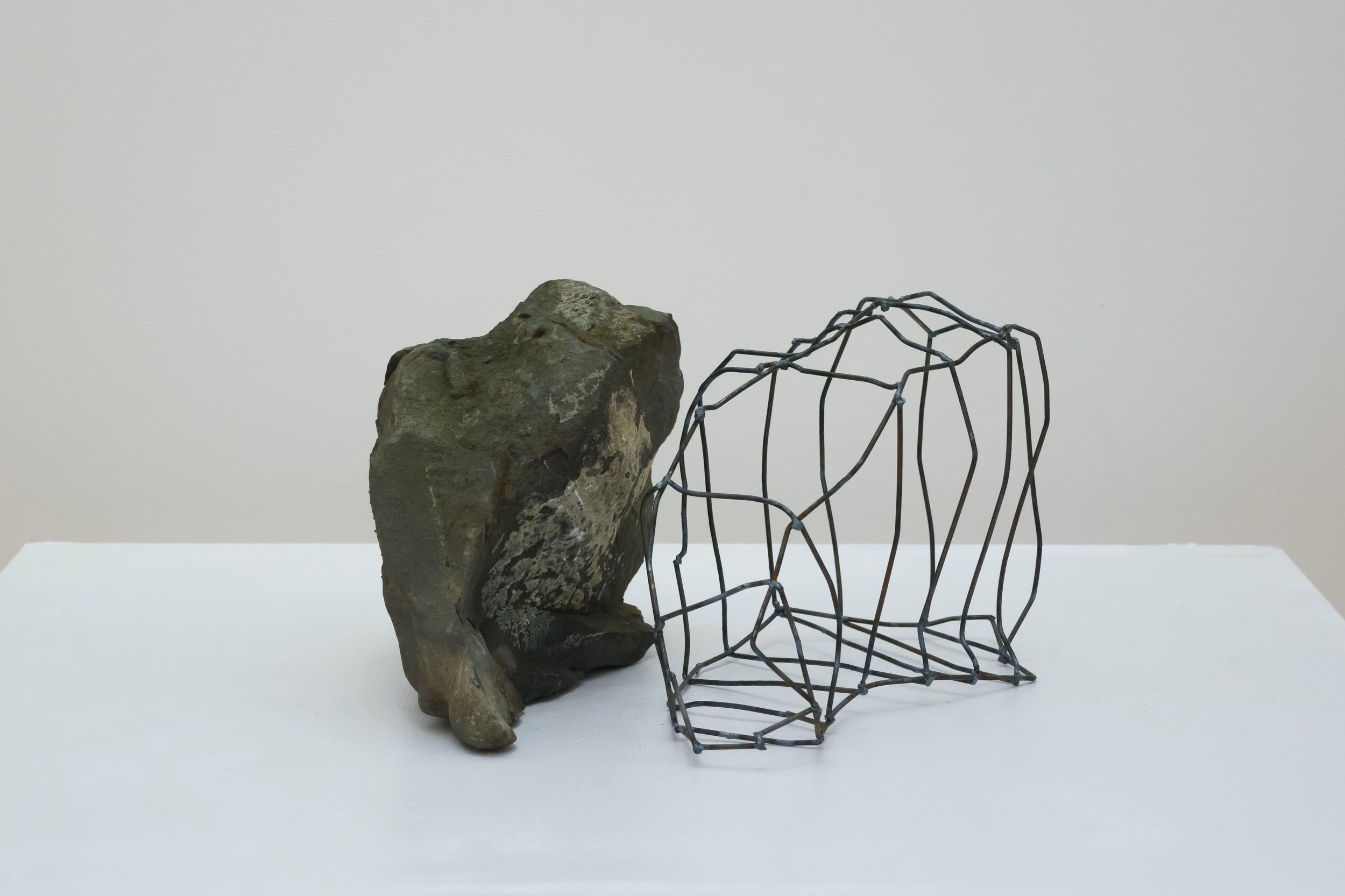 """Rock Cage: Let Go , 2015  Steel, Fieldstone, 10"""" x 17"""" x 18"""""""