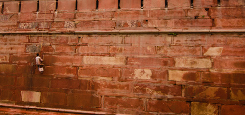 Maintenance being done on the exterior of the Red Fort walls