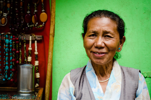Woman selling jewellery in her roadside stall