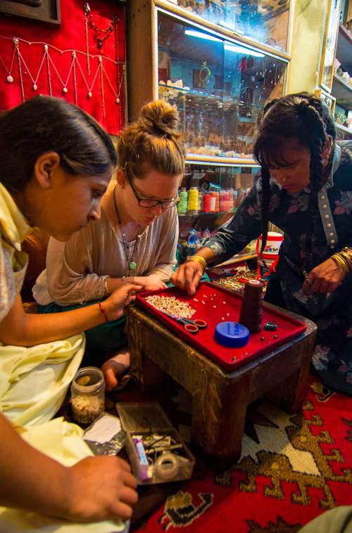 L-R: Pooja, Mikayla and Meena choosing beads