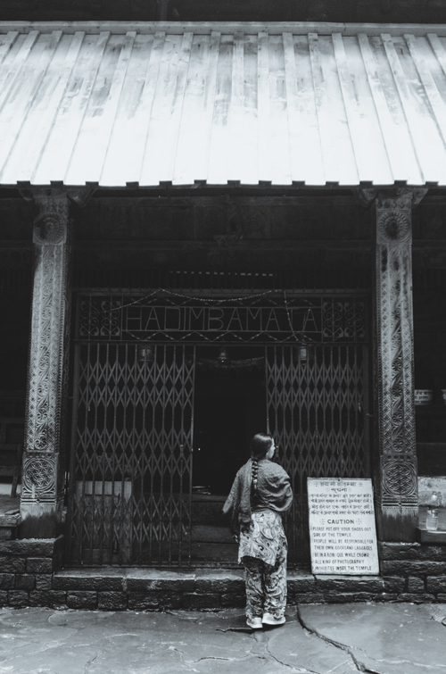 A woman stands at the entrance