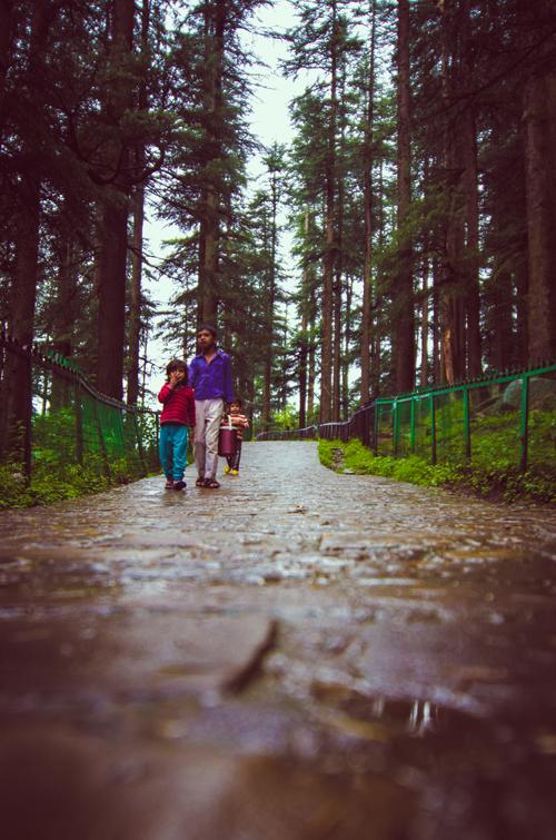 Children walking toward the temple