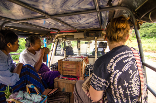 Our ride to Old Bagan in the back of a ute, sitting across from a lady smoking a coconut shell hookah.
