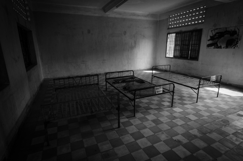 These were spaces used for the detention of Khmer Rouge personnel who were accused of sedition against the regime. The main cells are too small to fit one of these beds inside.