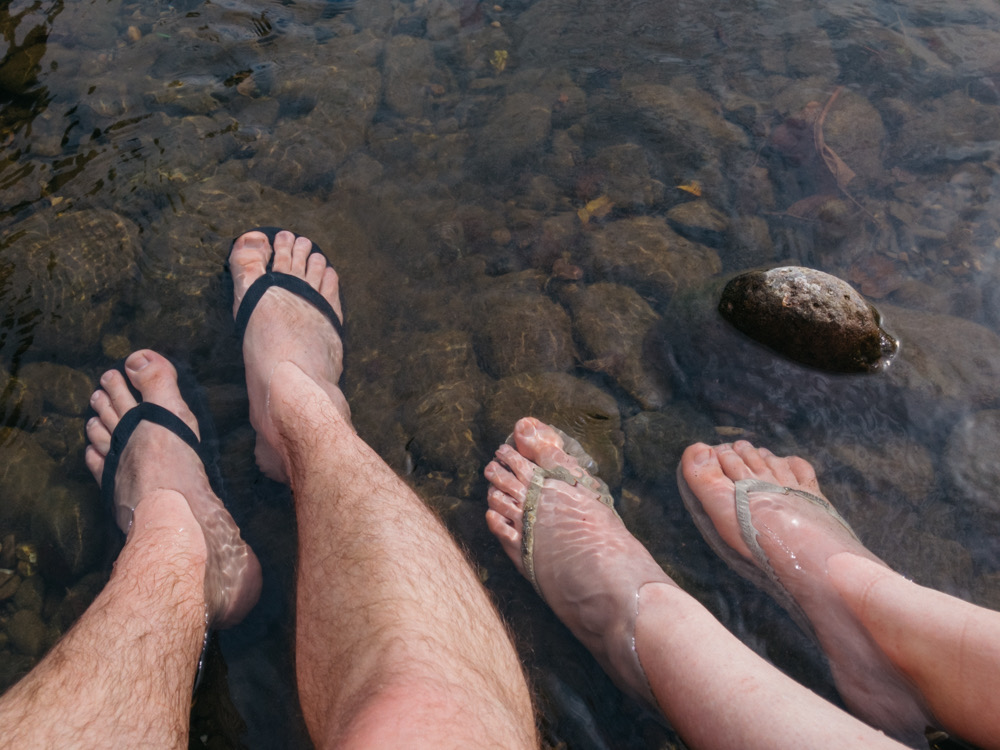Soaking our sore and swollen ankles in the freezing river in Zubiri - day 2