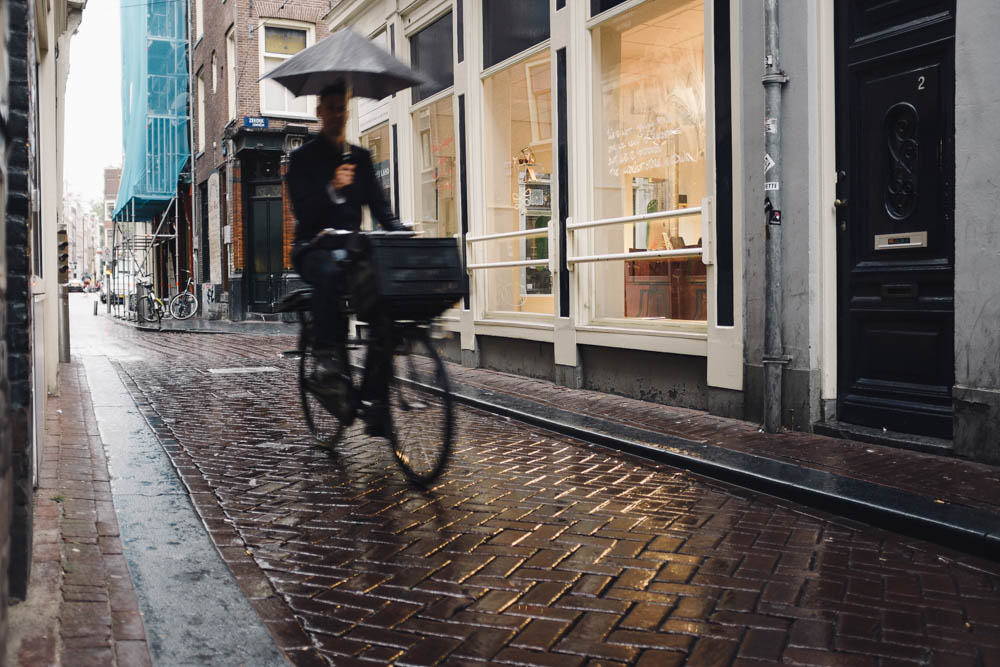When it started to rain in the early morning, I think I was the only person who was pleased. Umbrellas, water on cobblestones and reflections - who could ask for more?