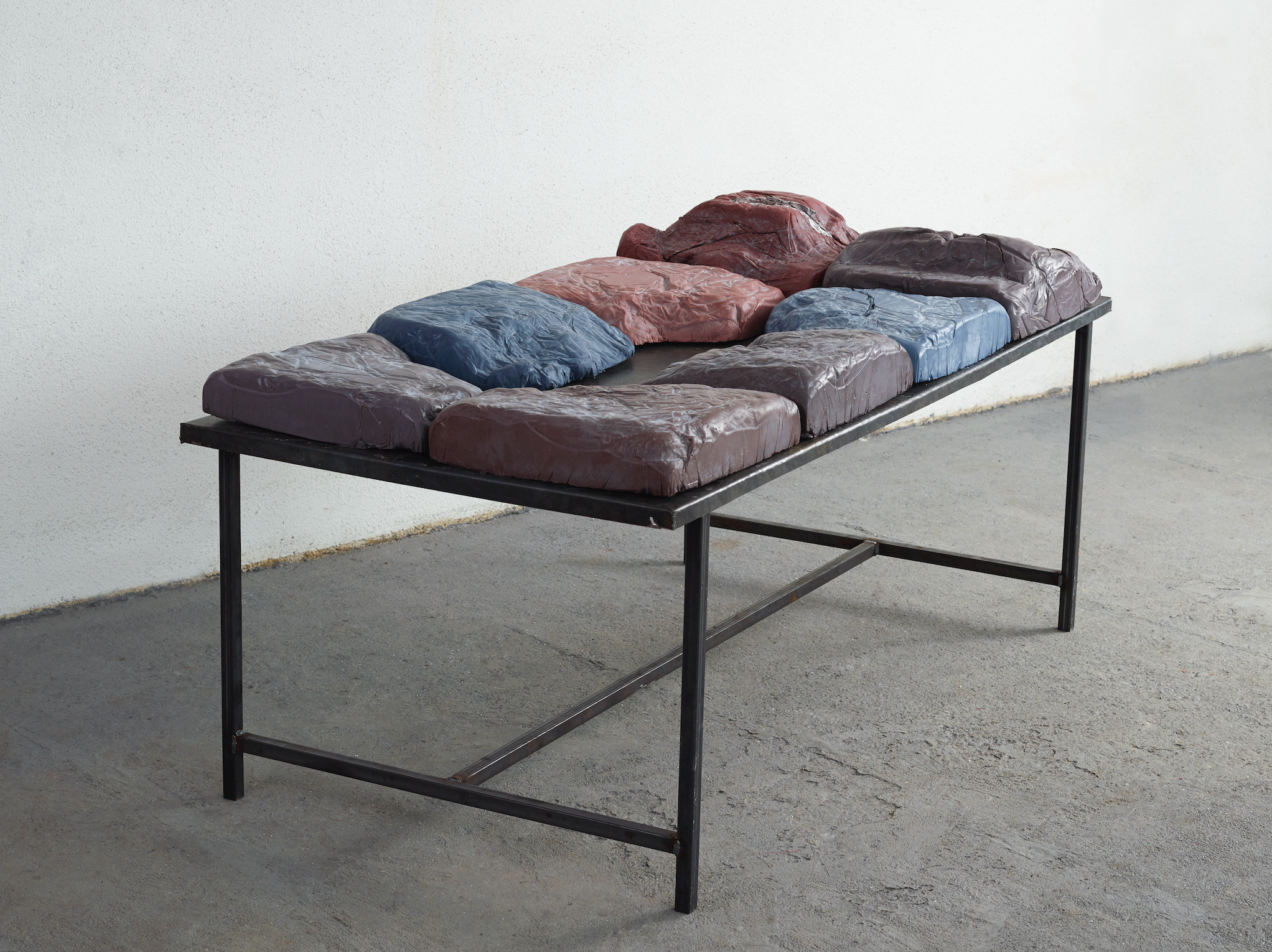 soap and metal table/  olive oil, coconut oil, lye, water, pigment/moulds made from the sheets and pillows of the artist's bed/2m x 1m, height 70 cm
