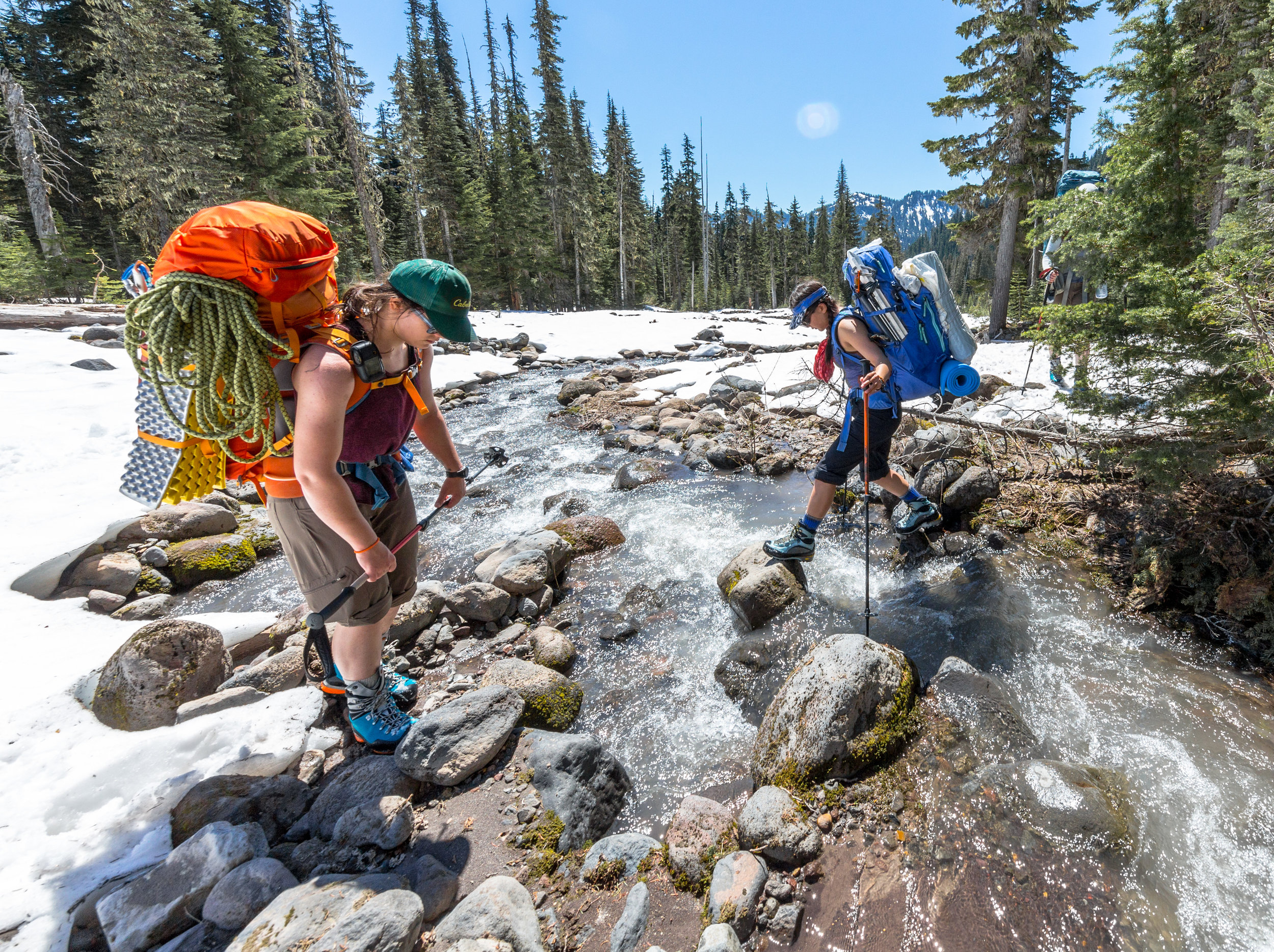 Loaded packs and creek crossings are a recipe for twisted ankles. Luckily we had mad skillz. Note the professional coil job on  Lea 's rope.