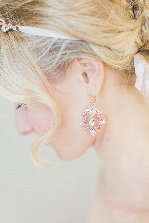 rose gold wedding earrings and hair vine