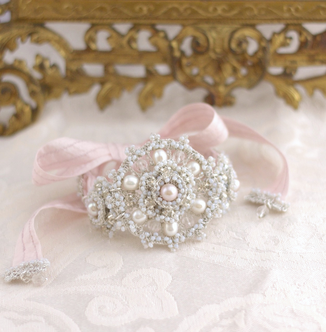 silver lace bridal bracelet with pink ribbon ties