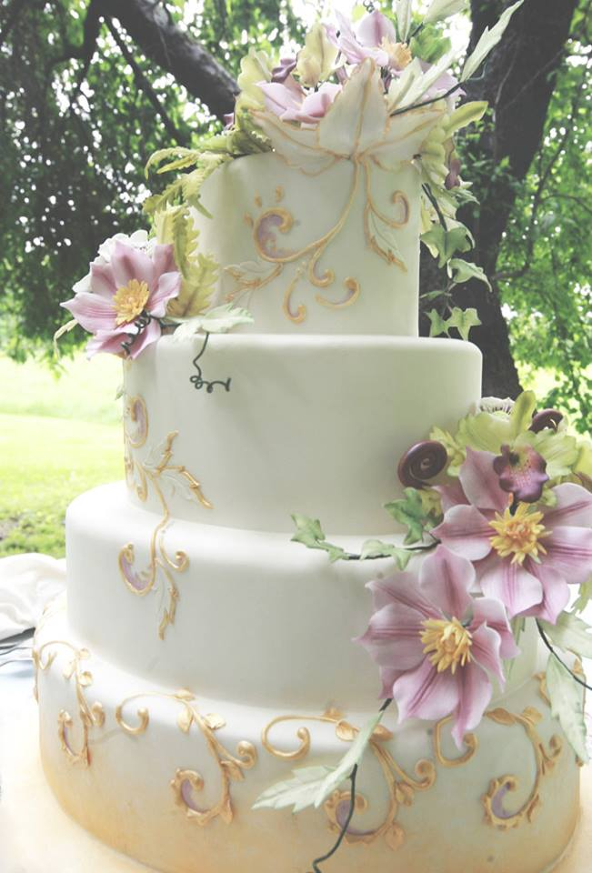 Vermont Wedding Cake with Flowers and Gold Icing