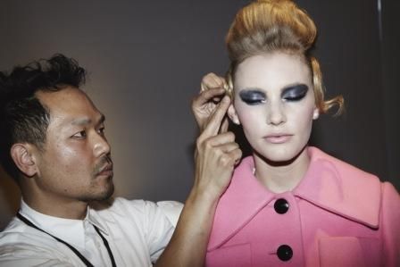 Kien Hoang puts the finishing touches to a model backstage at New York Fashion Week.