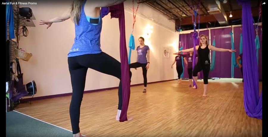 In the studio: students use aerial silks in class